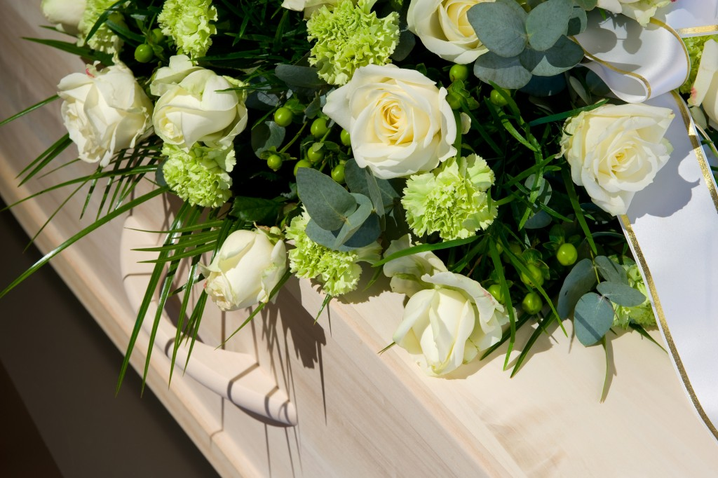 flowers on top of coffin