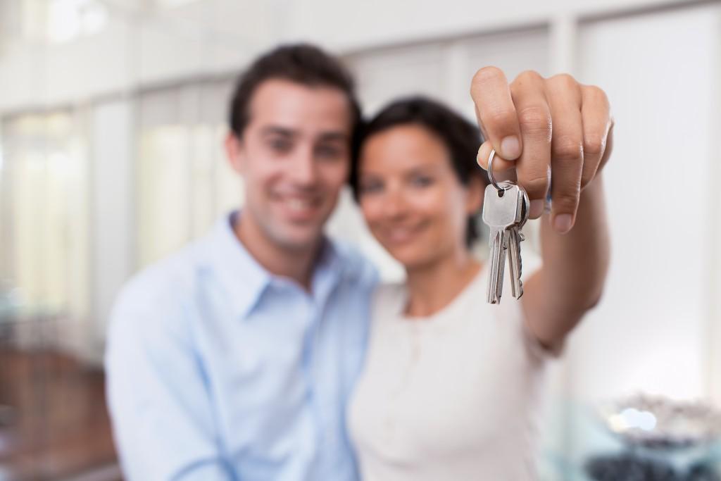 couple holding keys