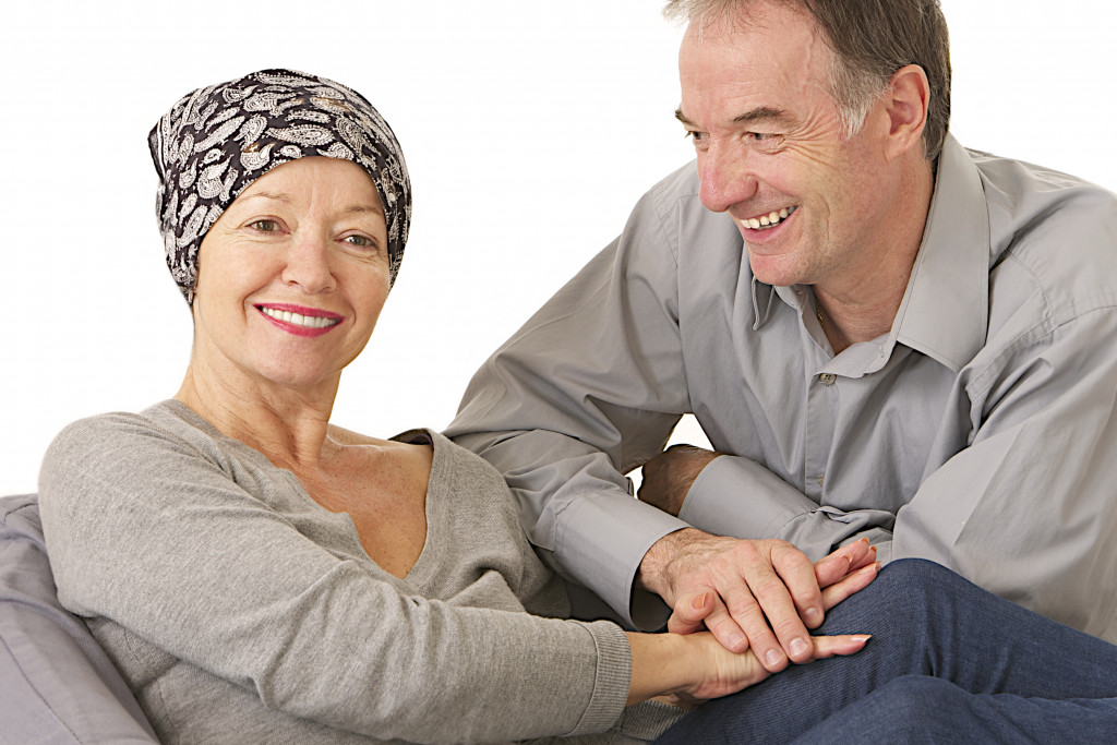 man supporting cancer patient