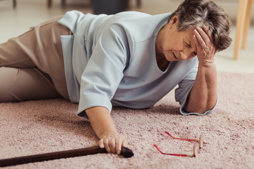 woman with cane fallen
