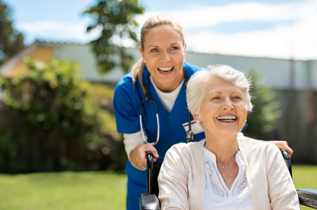 elderly woman being assisted by nurse